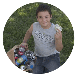 kid holding money from selling recycling